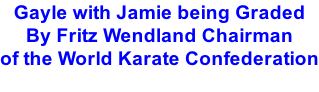 Gayle with Jamie being Graded By Fritz Wendland Chairman  of the World Karate Confederation